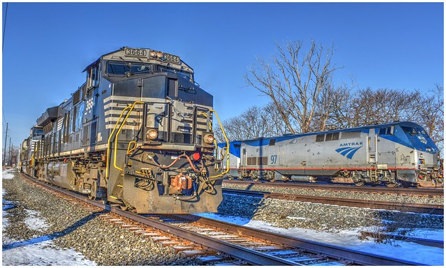 NS #3664 passing through fast, just as Amtrak's Lake Shore Limited train #48, begins to leave Erie Station.