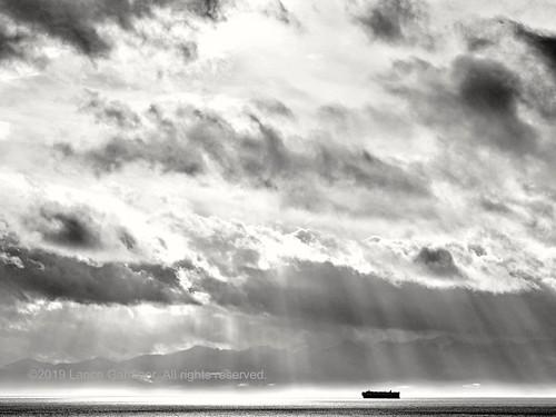 clouds cloudy storm sun sunshine ship freighter nikon nikkor jamesbay victoria britishcolumbia canada ocean pacific juandefuca dallasroad sea salish monochrome