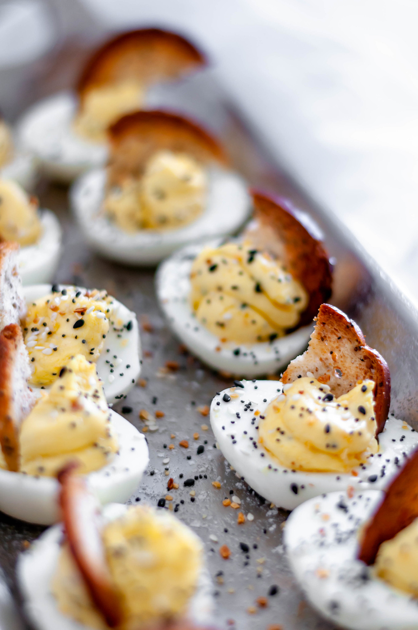 Everything Bagel Deviled Eggs are packed full of flavor. Cream cheese in the egg filling adds an extra creamy texture. Everything bagel seasoning adds tons of flavor. A bagel chip provides a nice crunch to the soft deviled egg.