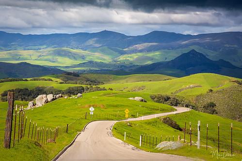 perfumocanyonroad prefumocanyonroad landscape road fence clouds horizontal rollinghills irishhills greenhills spring getty gettyimages mimiditchie mimiditchiephotography sanluisobispo california