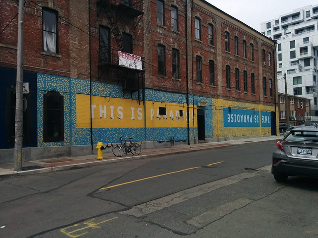 """This Is Paradise"" #toronto #queenstreetwest #cameronhouse #cameronstreet #mural #blue #yellow"