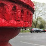 Red post box in the rain