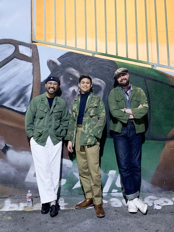 Ethan - milsurp boys Spencer, Mj - beanie. Navy crew neck sweater, jungle jacket, white wide leg chinos, cream socks, penny loafers