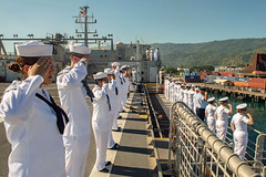 DILI, Timor-Leste (April 22, 2019) Pacific Partnership 2019 personnel salute while manning the rails of the fast expeditionary transport ship USNS Fall River (T-EPF 4) during its arrival in Timor-Leste. Pacific Partnership, now in its 14th iteration, is the largest annual multinational humanitarian assistance and disaster relief preparedness mission conducted in the Indo-Pacific. Each year the mission team works collectively with host and partner nations to enhance regional interoperability and disaster response capabilities, increase security and stability in the region, and foster new and enduring friendships in the Indo-Pacific. (U.S. Navy photo by Mass Communication Specialist 2nd Class Nicholas Burgains)