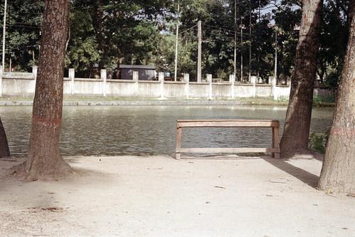 sheikhshahriarahmed travelphotography bench ashekmahmudcollege fujicolorc200 fujifilm nikonf80 bangladesh nikonn80 travel pond pacificimageprimefilm3650pro3 afternoon af50mmf18d jamalpur analogphotography leisure analog film