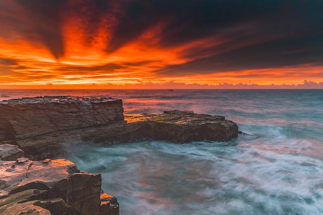 A Vibrant Flaming Sunrise Seascape