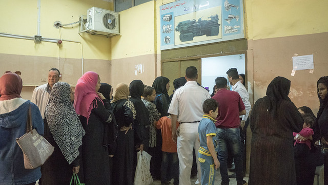 Egyptian women voters standing in queue in a polling station