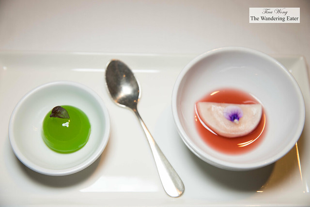 Amuse bouche - coconut, apple sphere (left) and lobster rice raviolo (right)