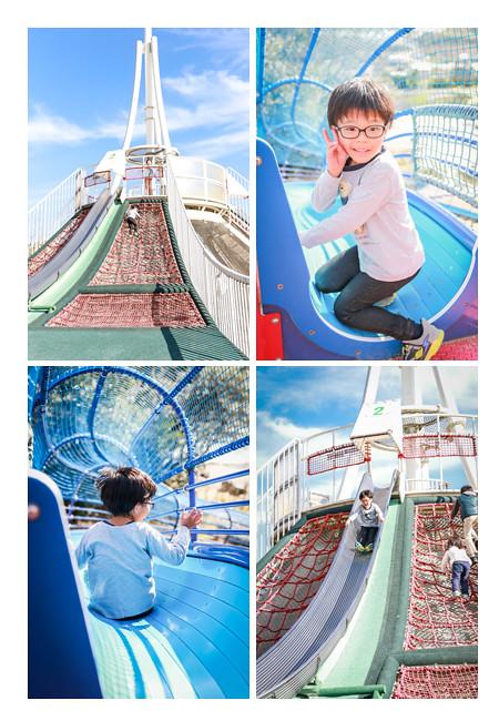 公園の大きなすべり台で遊ぶ男の子