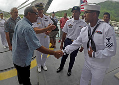 U.S. Navy Information Systems Technician 2nd Class KN Nethon from Uman, Micronesia, meets Peter Christian, president of the Federated States of Micronesia, during the Pacific Partnership closing ceremony aboard USNS Brunswick (T-EPF 6), April 25. (U.S. Navy/MC1 Tyrell K. Morris)