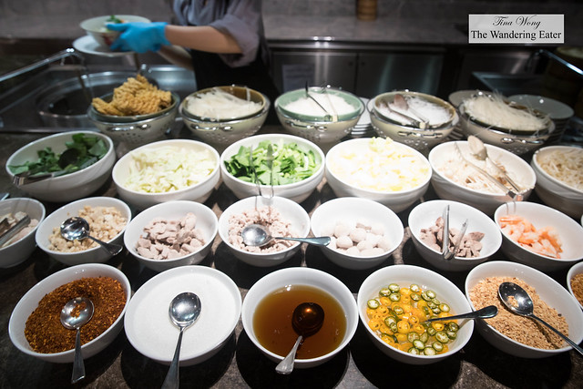 The various chioces for noodles, vegetables, proteins and toppings for your own noodle bowl at the JW Cafe during breakfast