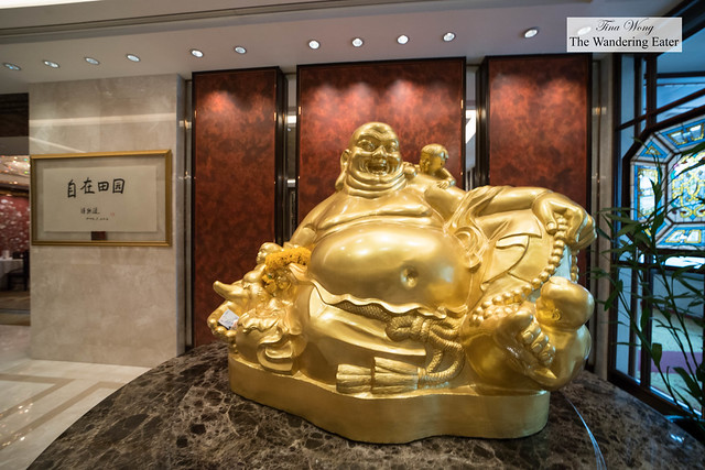 Enormous Happy Buddha at the Shang Palace restaurant