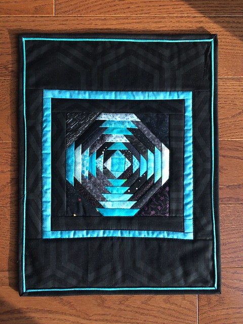 "Turquoise and black oineapple placemats. 13""x17"""