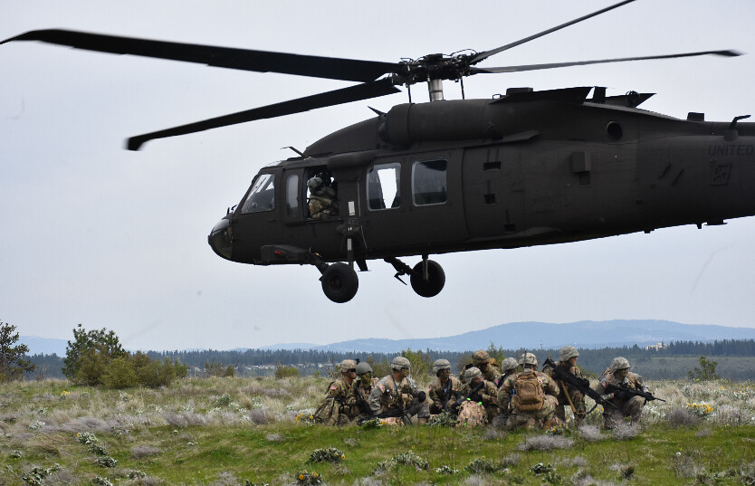 helicopter lands near a group of ROTC cadets
