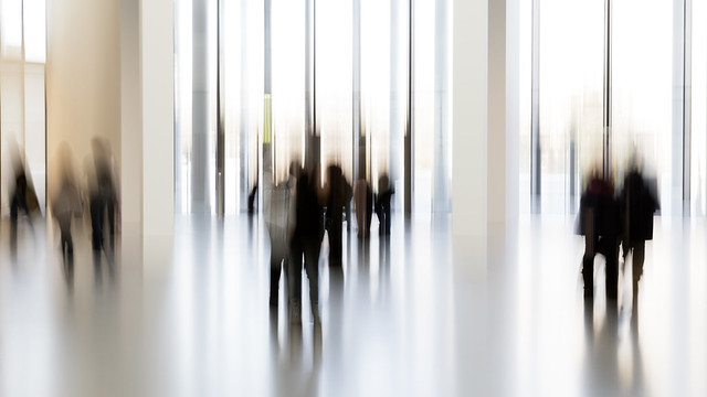 Silhouettes of people in a modern interior