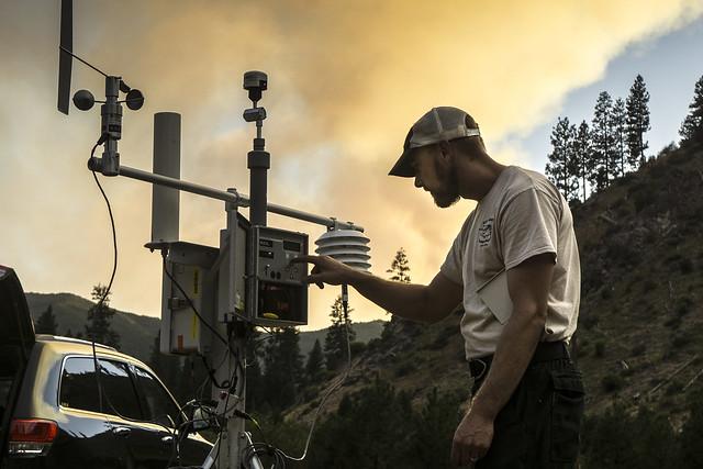 An Air Resource Advisor setting up a temporary smoke monitor