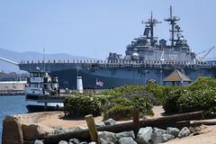 Sailors and Marines man the rails as the the amphibious assault ship USS Boxer (LHD 4) departs Naval Base San Diego, May 1. (U.S. Navy/MC2 Alex Millar)