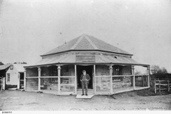 Simon Sibly standing outside his general store