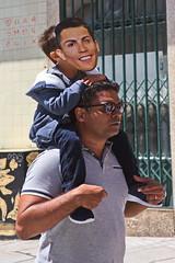 Cristiano Ronaldo on his father's shoulders