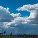 Sun, blue sky, clouds, rain and all at the same time. Highway 90 on the high plains near Mosses Lake, Washington.