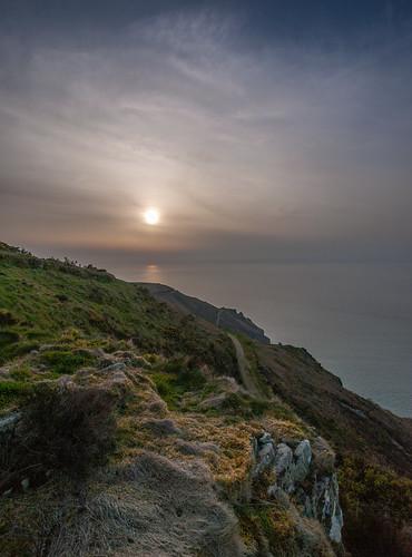 devon nature landscape sunset sun coast coastal coastpath haze rocks uk england south blue nopeople olympus colour