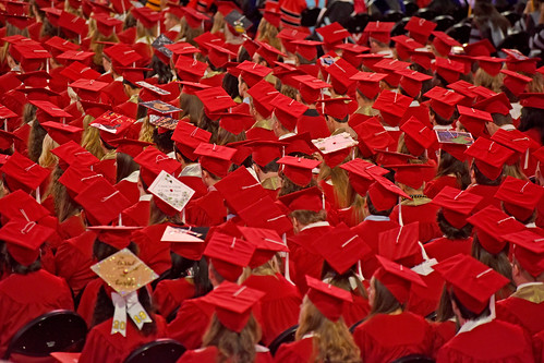 Sea of red mortar boards in PNC Arena.
