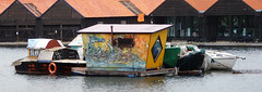 Boats and a floating home/shed in the counter-culture area of Copenhagen called Christiania, Denmark