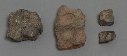 coin mold fragments found in Tadmekka, Mali