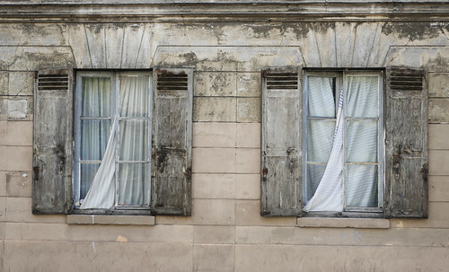 Curtains in the windows of an old building in Paris - Explore