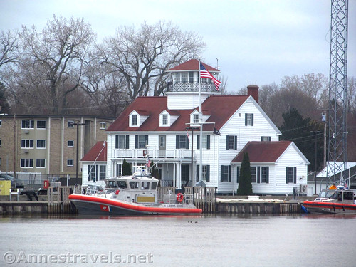 Coast guard building and boat, across the river from the Charlotte Pier in Rochester, New York