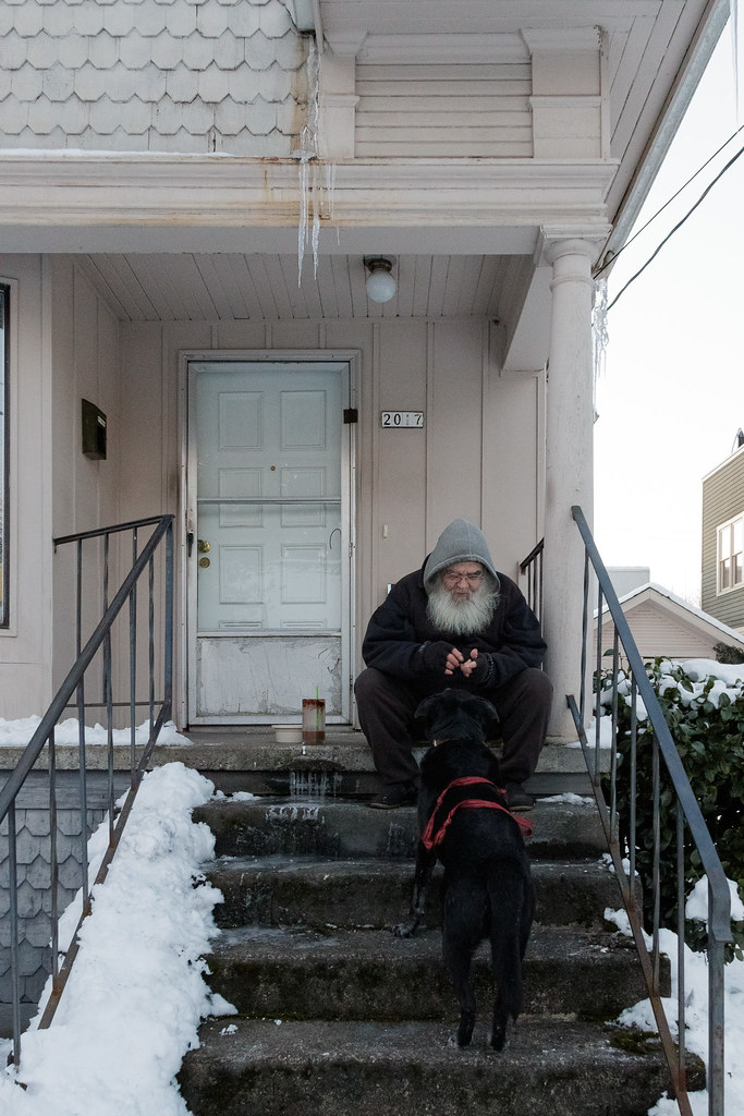 A neighbor feeds our dog Ellie treats from the steps of his house on a snowy day in the Irvington neighborhood of Portland, Oregon in January 2017