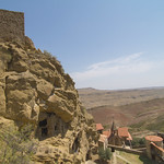Wide view of cliff top monastery and church below