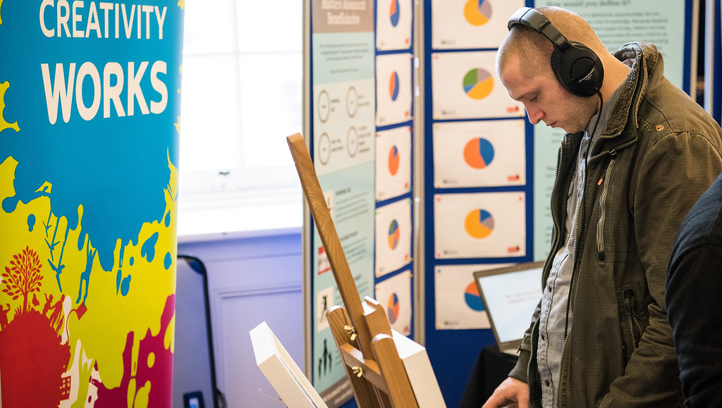 A visitor to a community exhibition looking at a display