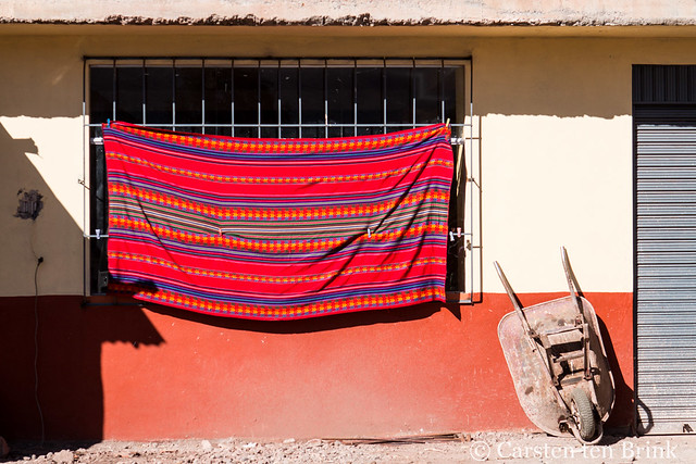Wheelbarrow and Inca textile