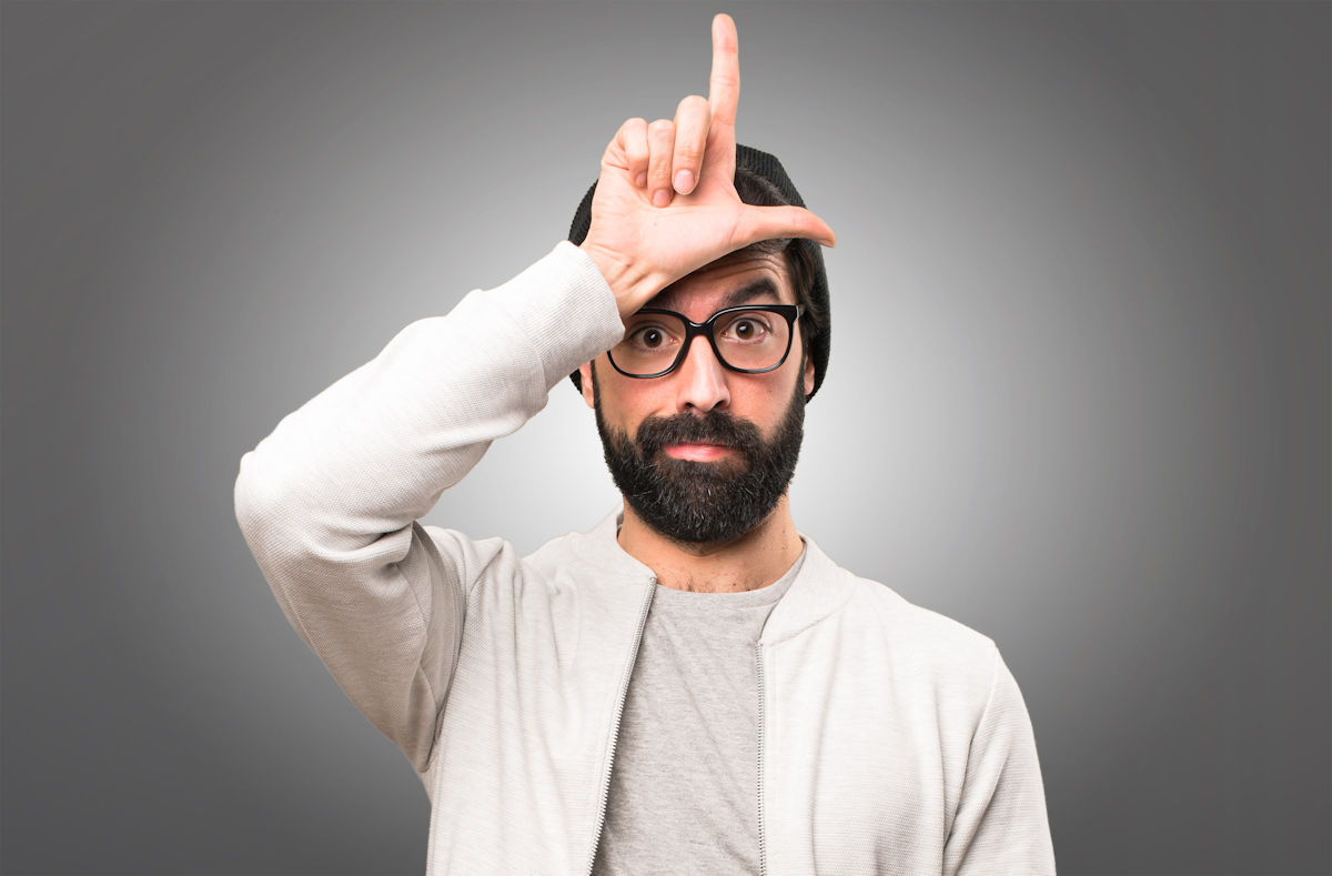 Man making loser sign on his own head.