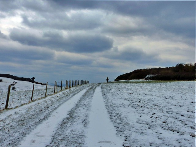 Pathway through the snow to the clouds