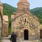 Armenian priest below 9th century Church of the Virgin