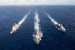 In this file photo, USS Mustin (DDG 89), USS Antietam (CG 54), USS Curtis Wilbur (DDG 54) andJS Fuyuzuki (DD 118) steam in formation during exercise MultiSail 2018. (U.S. Navy/MC3 Sarah Myers)