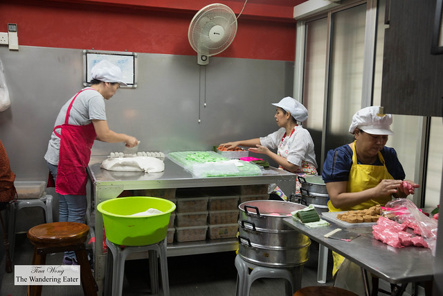 Older ladies making these Ang Ku Kueh 紅龜粿  or red tortoise cakes by hand