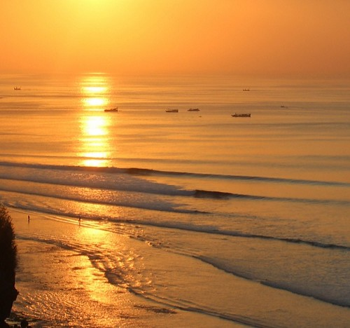 bali indonesia bingin sunset waves surfing surf ocean sea fishing boats beach people surfers sunrays orange seascape waterscape view