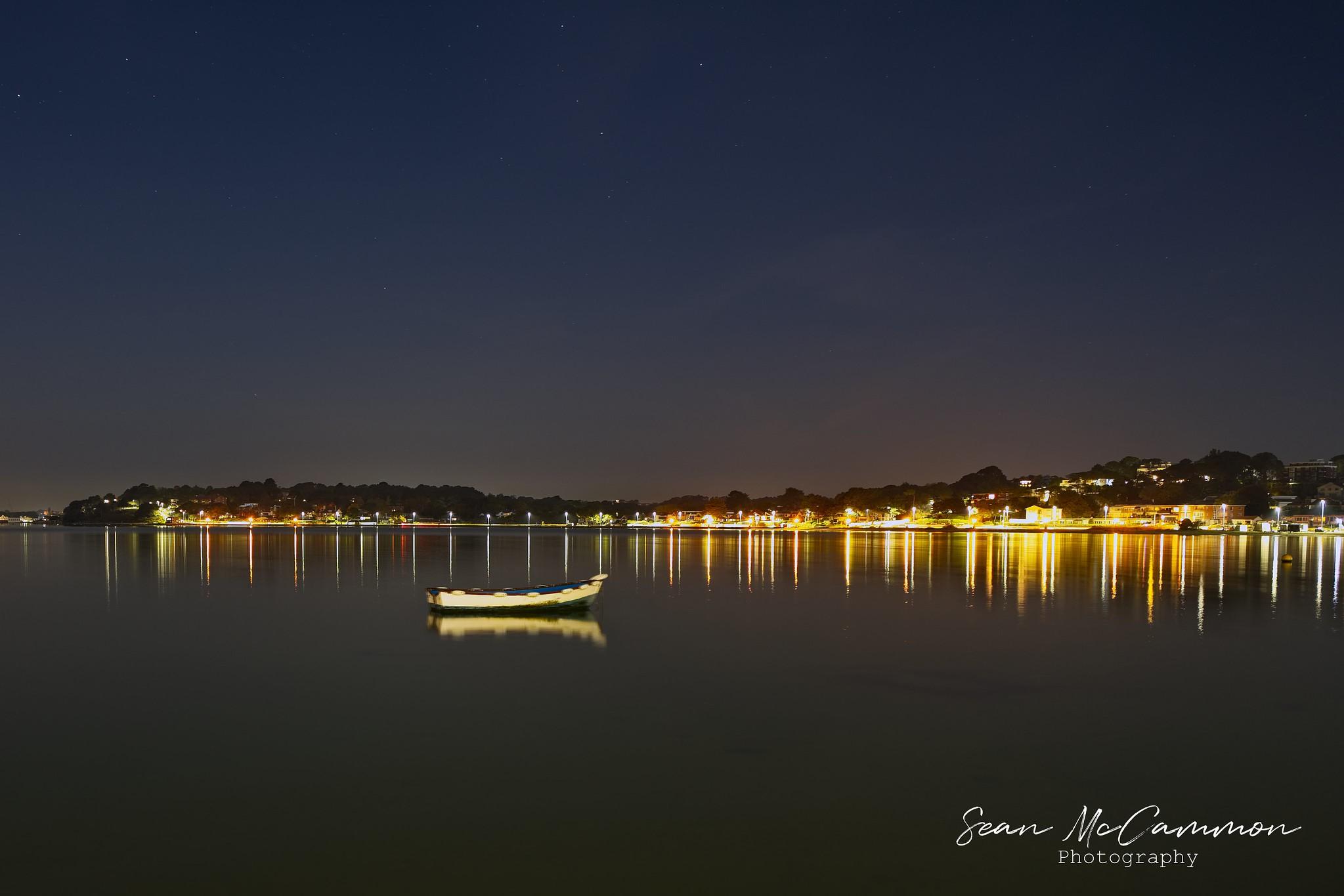 Boat at night in Sandbanks Bay