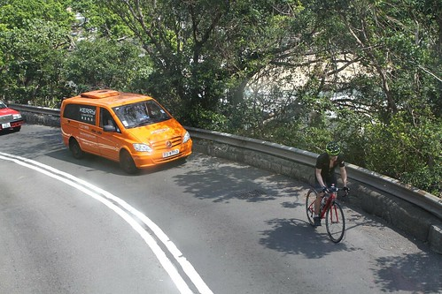 Cyclist on the hilly road to Repulse Bay