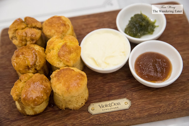 Plain and gula melaka (palm sugar) scones served with clotted cream, kaffir lime jam and pineapple jam
