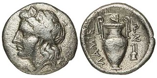 Ancient coin with Krater