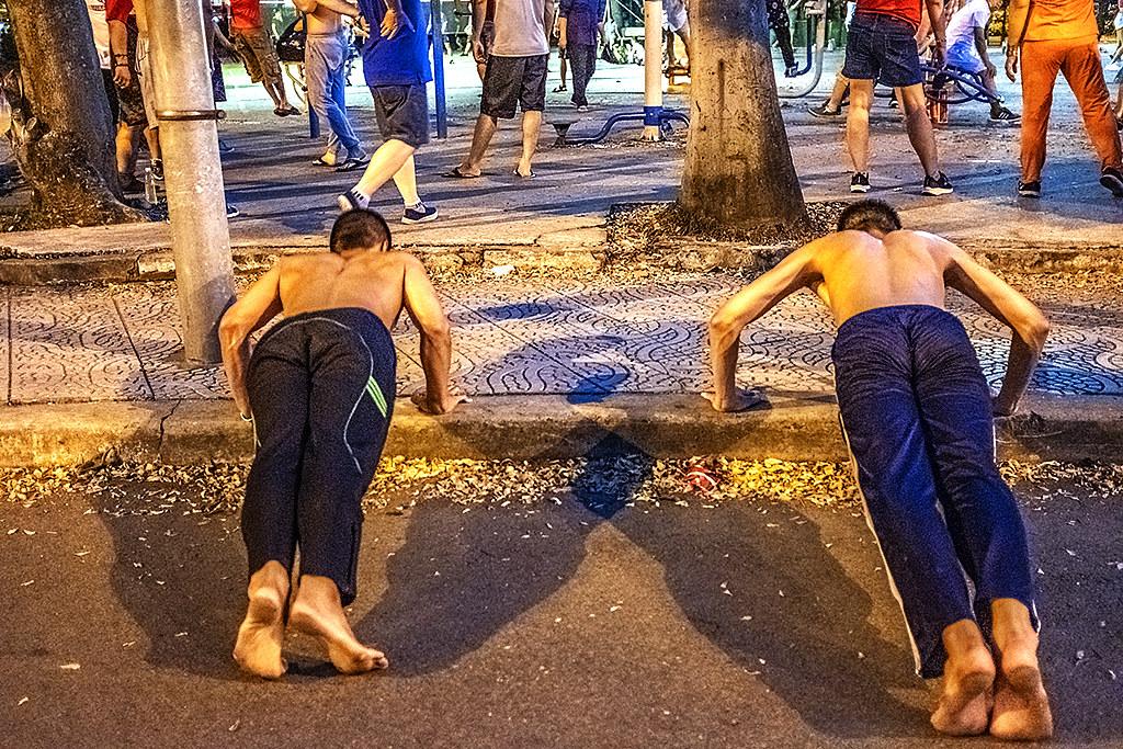Young men doing push ups in Binh Phu Park--Saigon