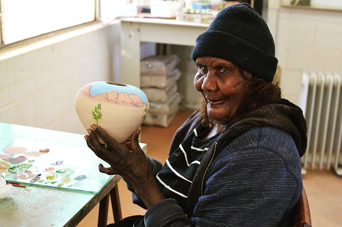 Featured Artist Dawn Ngala Wheeler of Hermannsburg Potters. Image courtesy of Hermannsburg Potters.