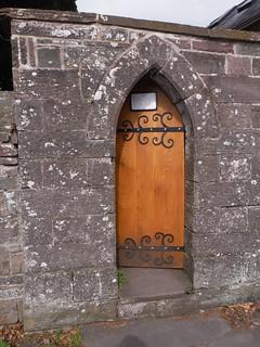 ...through a wooden gate in a wall into the churchyard of St. Mary & St. Cynydr, Llangynidr SWC Walk 332 Llangynidr to Bwlch or Circular