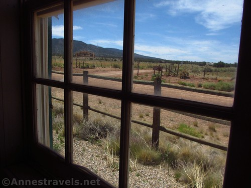 Looking out the window of the Mount Trumbull Schoolhouse at the road that heads south as the Whitmore Trail in Grand Canyon-Parashant National Monument, Arizona