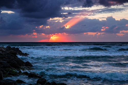 sea sunset clouds wind ray sun storm choppy dusk haifa israel beach tourism travel weather blue waves mediterranean levante
