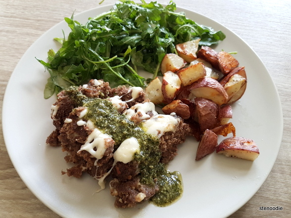 Baked Beef & Cheese meatloaf with Baby Arugula tossed in a Pesto Vinaigrette